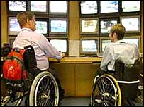 Wheelchair users in front of computers