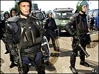 Portuguese riot police display their new equipment ahead of Euro2004