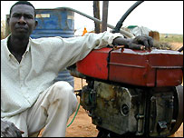 Ismael Ibrahim Ahmad Adam with his diesel-powered milling machine in Kirinding Camp, West Darfur, Sudan