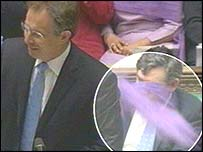 Tony Blair speaking as the dust passes behind him