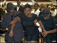 Woman overcome by grief at a police funeral