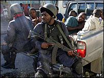 Haitian policemen with men arrested in Port-au-Prince raid
