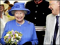 The Queen shares a joke with John Sugget, Chairman of the Isle of Wight Steam Railway