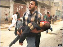 Injured child carried away from scene of attack in Rafah