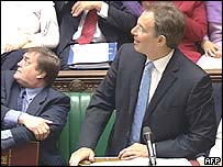 Tony Blair and John Prescott look up as the dust is thrown
