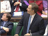 Tony Blair in the House of Commons as a purple powder is thrown at him