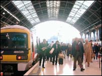 Train and travellers at Victoria Station, BBC