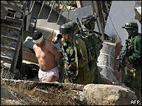Israeli soldiers arrest Palestinian militant leader Imad Qawasma in Hebron