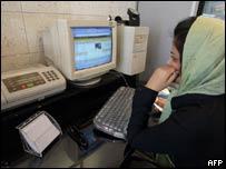 Iranian woman behind computer