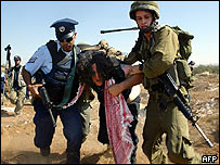 Israeli soldier arrests an activist