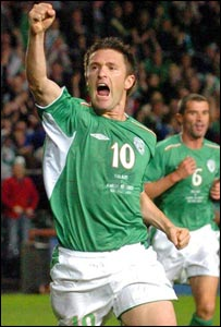 Robbie Keane reacts after scoring