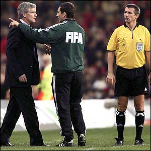 Mark Hughes argues from the dug-out but his side still lose 2-3 to Poland