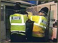 police arresting a violent drunk