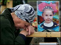 Woman mourns the death of a young girl in Beslan, 13 October 2004