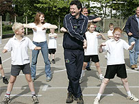 Wales' Sports Minister Alun Pugh is put through his paces by pupils at Gellifor Primary School