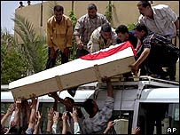 Iraqi mourners carry the coffin of Hussein Ali through Baghdad, 20 May 2004