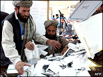 Afghans empty ballot boxes