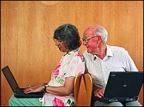 Elderly people using laptops