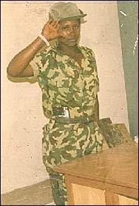 China Keitetsi as a child soldier, aged 13