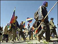 Aymara peasants march along a Bolivian altiplano road toward the capital La Paz on 13 October 2004