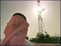 A Saudi oil worker watching a well