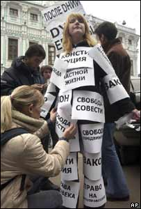 A member of the liberal Yabloko party prepares to protest