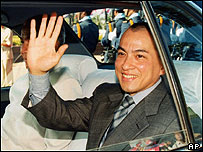 King Norodom Sihamoni waves from a car during a ceremony of Independence Day , 2002