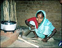 Indian woman cooking with basic stove. Pic by Marc Lopatin