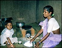 Mother and child with basic cooking conditions. Pic by Marc Lopatin.