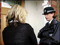 Education welfare officer and police officer on doorstep