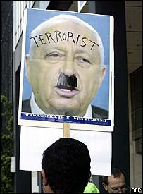Demonstrator at Israeli consulate in Los Angeles with poster of Prime Minister Ariel Sharon