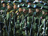 Japan's first troops of main contingent soldiers stand in formation upon arrival at the Dutch military base in Samawah, Feb. 8, 2004