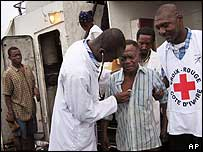 A Red Cross doctor examines a refugee aboard the ship on Friday