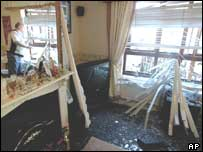 Sam Cowan surveys the bomb damage to his house