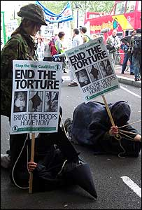 Demonstrators dressed as a soldier and tortured prisoners