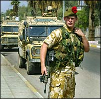 Kevin Morgan, from Dunfermline, on an early morning patrol in Basra with the Black Watch