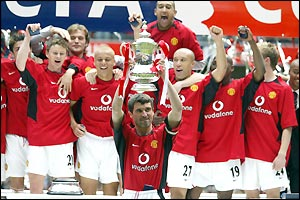 Manchester United captain Roy Keane lifts the FA Cup - surrounded by his delighted team-mates
