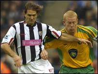 West Brom's Andy Johnson challenges with Norwich's Gary Holt