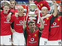 Man Utd skipper Roy Keane lifts the FA Cup last year