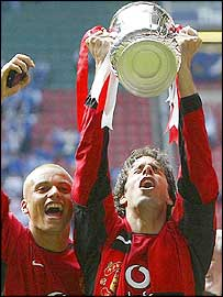 Double goal-scorer Ruud van Nistelrooy (right) celebrates with team-mate Wes Brown