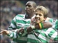 Goalscorers Henri Camara and Juninho celebrate