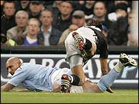 Nicolas Anelka is brought down by Chelsea's Paulo Ferreira to earn Man City the penalty from which he scored the winner