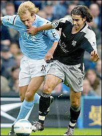 Man City's Paul Bosvelt (left) and Tiago battle it out at Eastlands