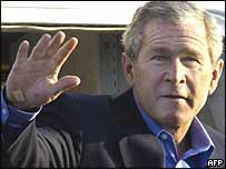 George Bush reveals a grazed chin and a plaster on his right hand