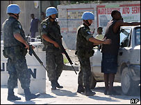 Brazilian peacekeepers check a man in Port-au-Prince