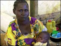 A Ugandan woman holding her baby in a hospital waiting area