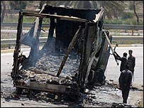 A US army truck is pulled apart on a Baghdad highway