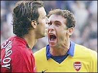 Arsenal's Martin Keown (right) lets Ruud van Nistelrooy know his feelings after the Man Utd striker missed a penalty during their infamous match last season