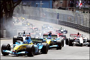 Renault get a great start as Jarno Trulli gets away first and his team-mate Fernando Alonso overtakes Jenson Button