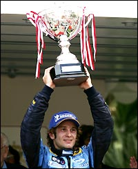 Renault's Italian driver Jarno Trulli poses with the winner's trophy after triumphing in the Monaco Grand Prix